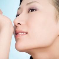 woman-smelling-perfume