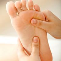 hands-massaging-feet