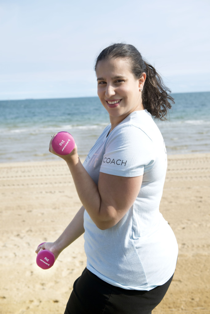 Heba-dumbbells-beach-terrafit
